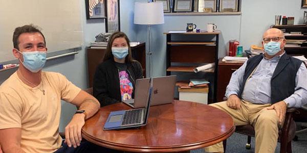 Law students Landon Foody and Rebecca Hanniford meet with Professor Brian Krumm
