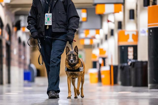 Corporal Mary Cameron and K9 Tica work the indoor concourse at Neyland Stadium