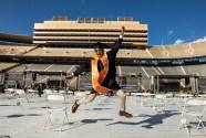A graduate jumps for joy.