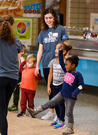 Cousins, with Vols En Pointe, works with kids during a ballet class with the SHADES of Development after school program at Fort Sanders Developmental Center.