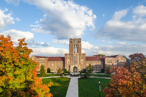 Wide shot of Ayres Hall in Autumn with beautiful blue sky.