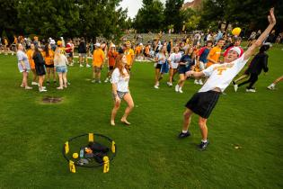 Students play spike ball during the first-year picnic held at the Humanities Plaza
