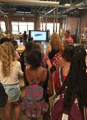 Students tour the Fabrication Lab with a UT College of Architecture and Design guide.