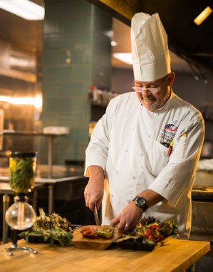 Chef Greg Eisele preparing a meal