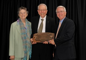 Dr. John Prados (center) and his wife Mrs. Lynn Prados (left) with COE Dean Wayne Davis at the presentation of the Nathan W. Dougherty Award at the College of Engineering's Faculty and Staff Awards Dinner.