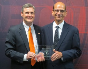 College of Communication and Information Dean Mike Wirth (left) with Paul Finebaum.