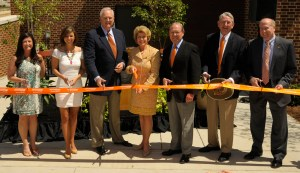 Cutting the ribbon to officially open the new Sorority Village Center are Sorority and Fraternity Life Advisor Lindi Smedberg, Panhellenic President Mary Beth Overton, Sam Furrow, Ann Furrow, Chancellor Jimmy G. Cheek, Governor Winfield Dunn, and Vice Chancellor for Student Life Tim Rogers.