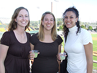 Thornton Academic Student Life Center employees (left to right) Arielle von Boettinger, Emily Morgan and Jacqui Schuman enjoy the lemonade at the renovated Lindsey Nelson Baseball Stadium
