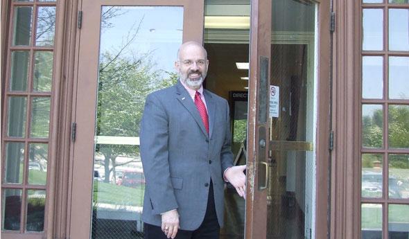 Joseph DiPietro standing by a door