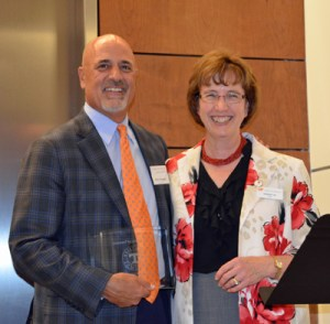 Chairman and CEO of P.F. Chang's China Bistro Inc. Rick Federico receives the Accomplished Alumni award from UT College of Arts and Sciences Dean Theresa M. Lee.
