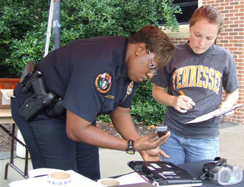 UTPD Sergeant Meshia Thomas helps a student register her laptop with the police department. Registering personal property with UTPD helps the police recovers items if lost or stolen.