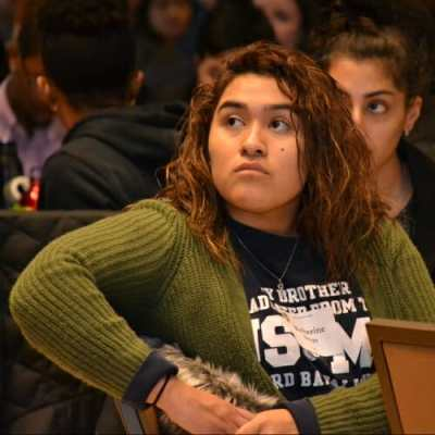 Photo: Seated students listening to speaker