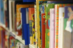 Photo of a row of children's books in the library