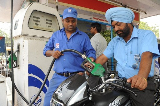 Petrol Pump employee fill the tank of a motorbike (AFP)