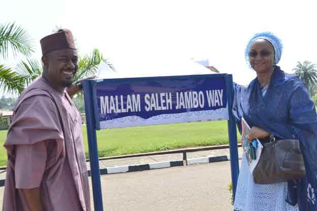 "Mallam Saleh Jambo's children Mr Bashir Jambo, and Mrs Aisha Jambo-Dikko, unveiling the  ""Mallam Saleh Jambo Way"", a street within the Olashore school compound,  named in honour of their father who was one of the Founding Board of Governors in Olashore International School, recently at Olashore International school's Prize Giving Day in illoko-ijesha, Osun State"