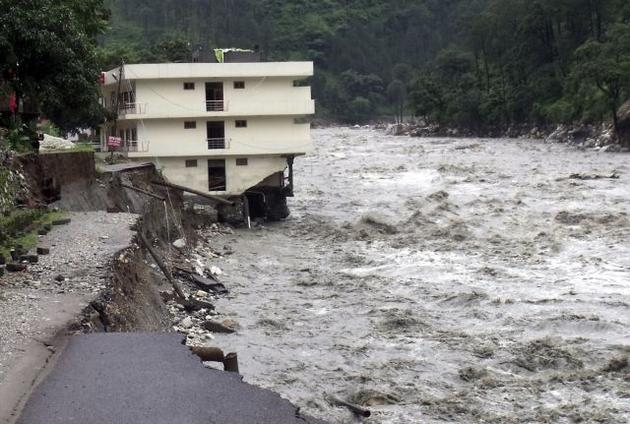 Building washed away in flash floods in the Uttarkashi district of Uttarakhand state on Sunday