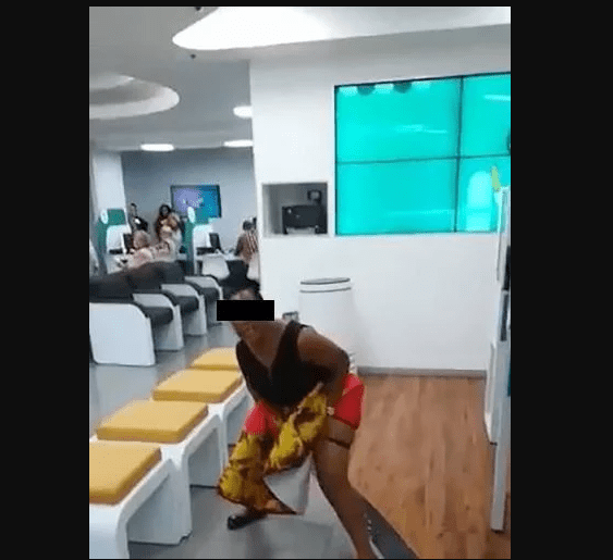 Woman pees on floor at FNB Bank