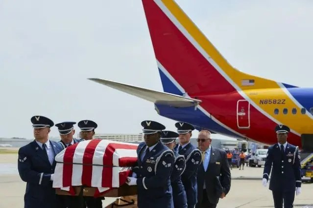 Son flies father's remains home