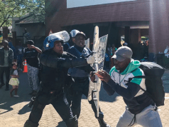 refugees clash with police