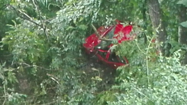 Driver rolls car down