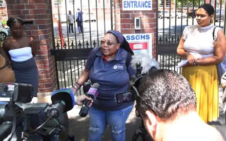 The mother of San Souci Girls' High School addresses the media a day after her daughter was slapped by one of her teachers
