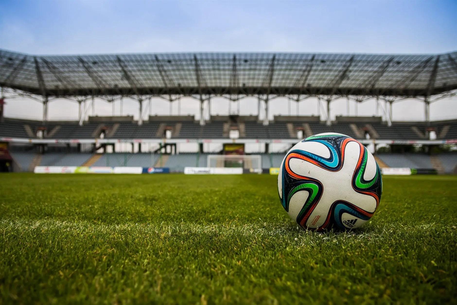 soccer ball on grass pitch