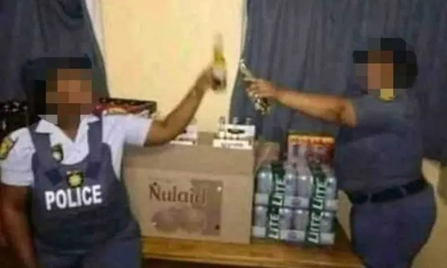 Police officers posing with Alcohol