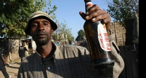 man holding beer