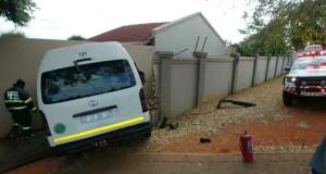 taxi crashes through wall