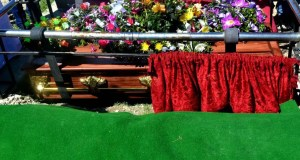 Chaos at funeral as man shoots mourning wife