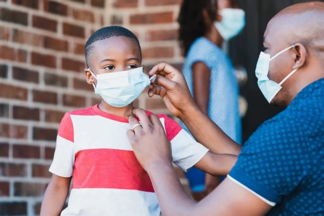 children wearing face masks