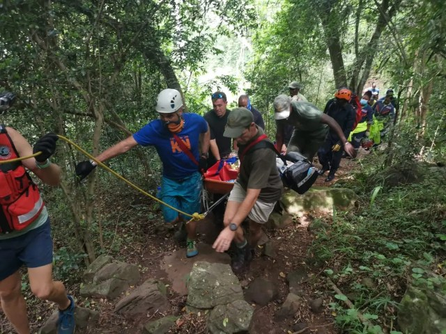 Woman rescued after falling at waterfall
