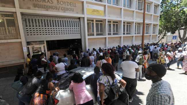 Hundreds of people queue outside the Labour Department building in the Cape Town CBD on Friday to claim their UIF grants