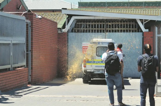 Angry Khayelitsha man throws 5 litres of his own poop at police van after they took his speaker