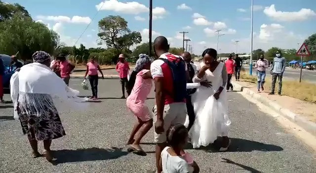 Drama at wedding as side chick and baby mama attacks her Boyfriend's wife