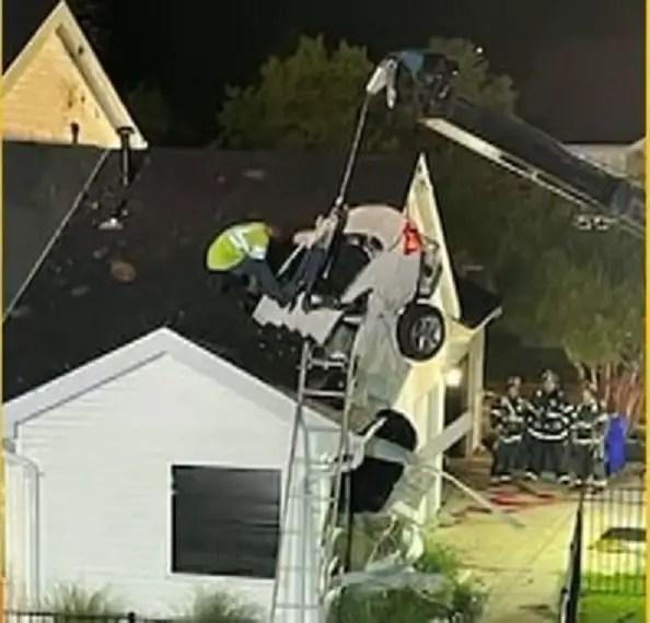 Video: Speeding car crashes through roof of a house