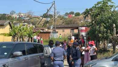 Police Minister Bheki Cele at one of the homes where a group of people were gunned down