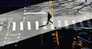 A person crosses the street in New York
