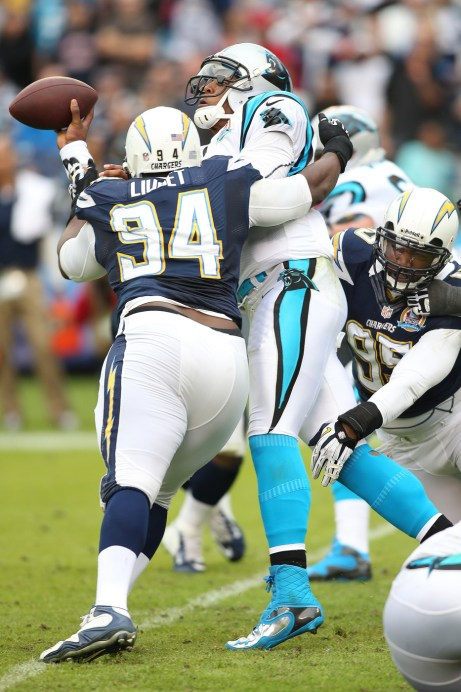This is one of the few times that the Chargers were able to knock Cam Newton off of his feet. Photo Credit: Mike Zito