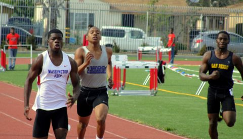Thundering home: Zendon Pandy of Washington Prep High School, outduels Angel Valencia at the Marine League Track and Field Finals. Photo: Dennis J. Feeman