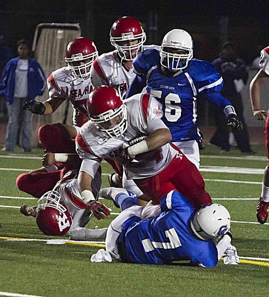 Jamaal Perkins of Redondo Union gets the best of a Culver City defender. Photo Courtesy of Jevone Moore/Full Image 360