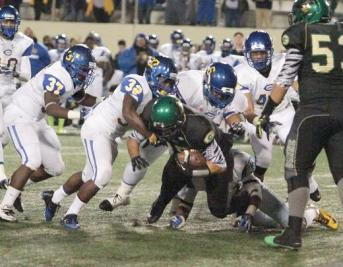A Narbonne runner feels the squeeze of Crenshaw's defense. Photo Credit: Jevone Moore/News4usonline.com
