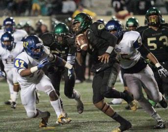 Narbonne quarterback Eban Jackson on the run against Crenshaw's defense. Photo Credit: Jevone Moore/News4usonline.com
