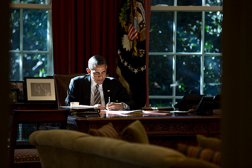 """""""Light matters. The paper that the President was writing on provided some fill light as he worked at the Resolute Desk in the Oval Office.""""  (Official White House Photo by Pete Souza)"""