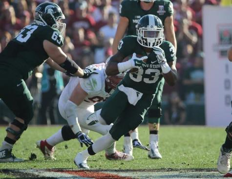 Michigan State running back Jeremy Langford doing his thing. Photo Credit: Jevone Moore/Full Image 360