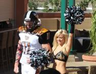 A player and cheerleader get into the spirit. Photo: Jevone Moore/News4usonline.com