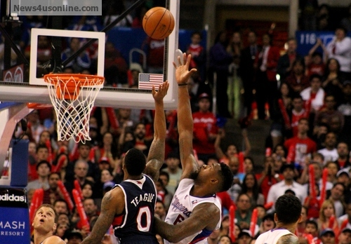 Not this time: DeAndre Jordan contests a last-second shot attempt by the Hawks' Jeff Teague. Photo: Dennis J. Freeman