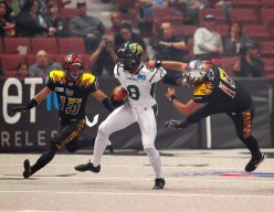 LA Kiss Kicker Kenny Spencer trying to slow down Kick Returner Clevan Thomas Photo Credit: Jordon Kelly /News4usonline.com