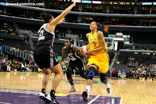 Making an impact: Candace Parker's all-around game helped the Los Angeles Sparks win their first home game of the season. Photo Credit: Dennis J. Freeman/News4usonline.com