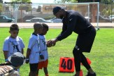 Jacksonville Jaguars and NFL star and Long Beach Poly High alumni Marcedes Lewis hand out some football tips at his annual youth football camp on Saturday, June 14. Photo Credit: Dennis J. Freeman/News4usonline.com